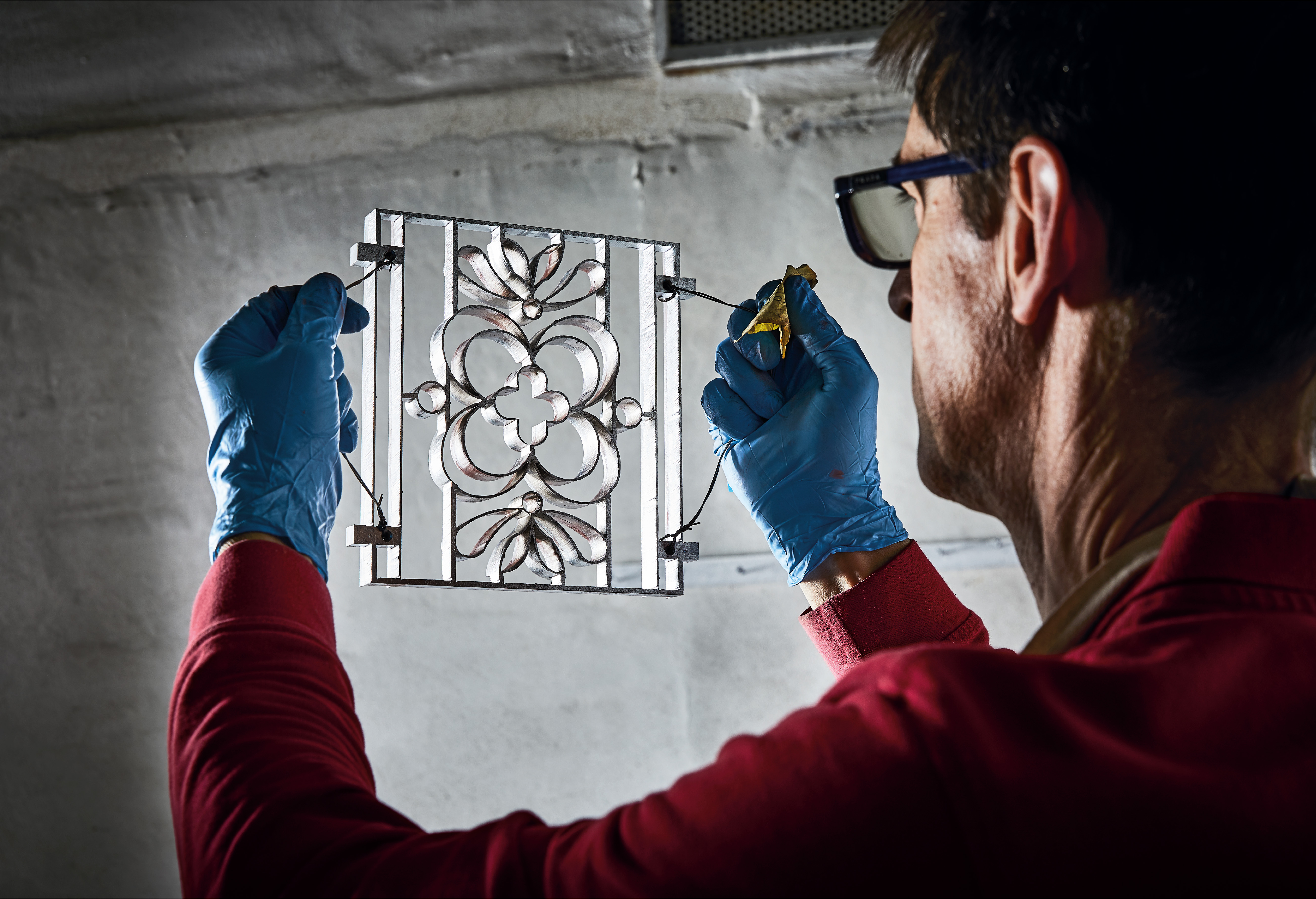 A Bisazza Technician Inspects A Cement Tile Mould